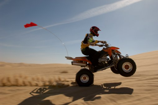 How to Pop a Wheelie on ATV or Dirt Bike