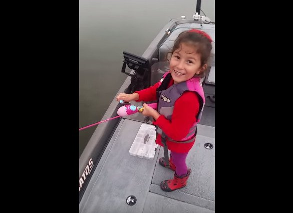 Adorable little girl reels in large bass on barbie rod and for Barbie fishing pole