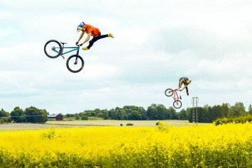 BMX Riders Fly Through Fields of Blooming Flowers