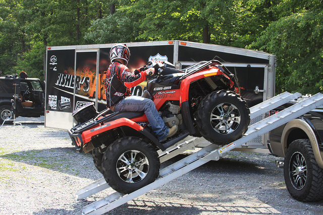 Use a ramp or trailer foot
