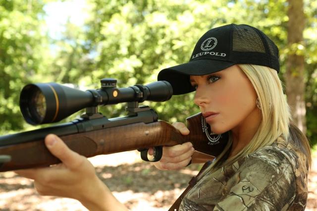 blonde-girl-shooting-bow